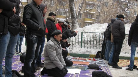 Praying in the snow in Moscow