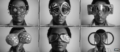 Kenyan artist Cyrus Kabiru posing with artwork resembling sunglasses on February 1, 2012 in Nairobi