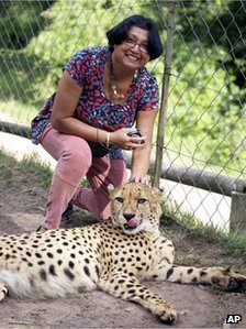 Violet D'Mello posing with a cheetah