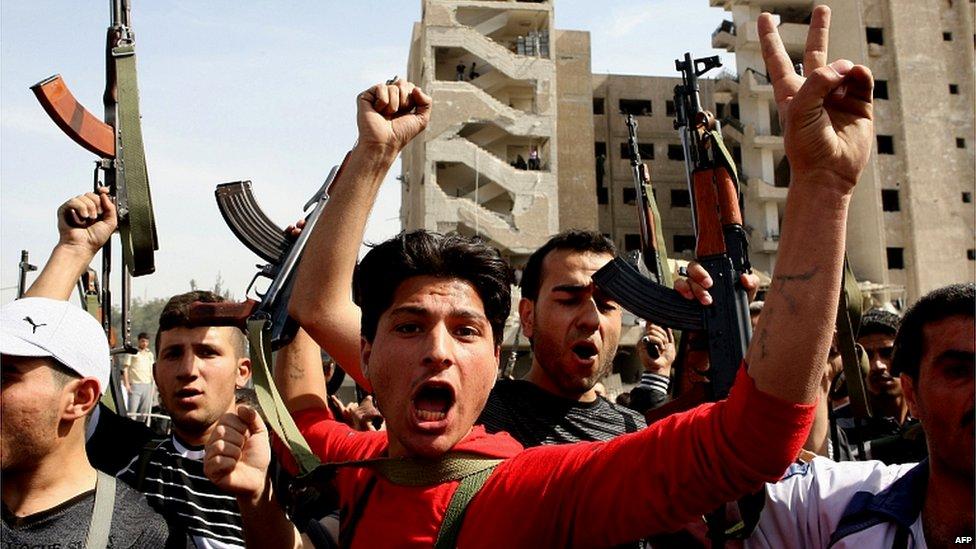 In background: Al-Qazzaz Intelligence Compound