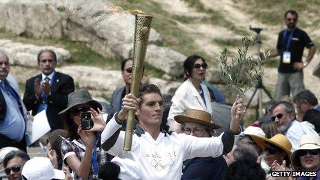 World champion swimmer Spyros Gianniotis with the torch