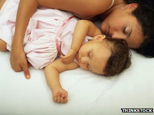 Mother and baby asleep