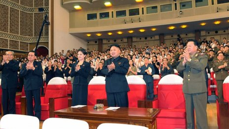 "North Korean leader Kim Jong-Un (C) applauds during a demonstration performance by the newly formed Moranbong band in Pyongyang in this undated picture released by the North""s KCNA July 9, 2012"