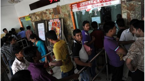 Bangladeshi cinema goers queue for tickets at a movie theatre in Dhaka on July 6, 2012.
