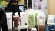 Woman displaying halal products