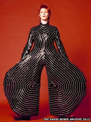 David Bowie in Aladdin Sane bodysuit. Photo by Masayoshi Sukita