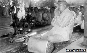 Former king, Norodom Sihanouk (1955 picture), prays with monks after abdicating