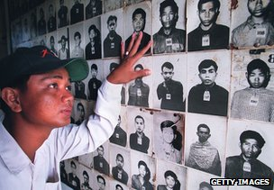 Man looks at pictures of slaughtered Cambodians at Tuol Sleng Prison in Phnom Penh