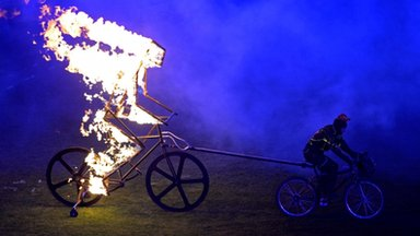 Flaming cyclist enters closing ceremony