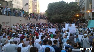 People attend a rally in front of the US embassy to protest against a recently produced movie insulting Prophet Muhammad in Cairo