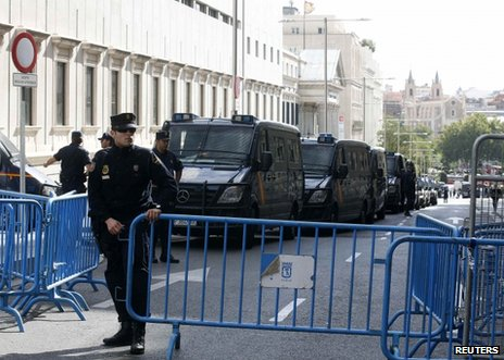 Police guard the Spanish parliament in Madrid, 25 September