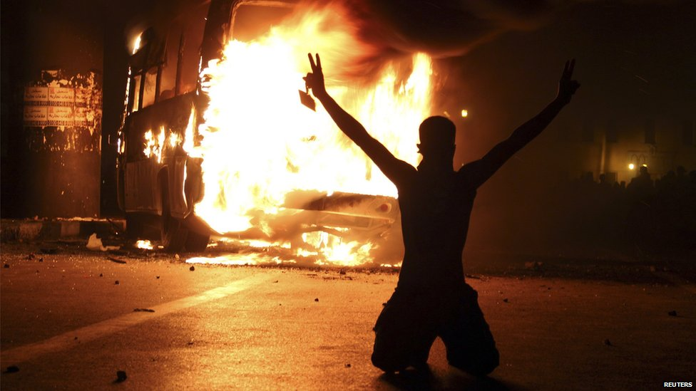 Protester by burning bus in Cairo. 12 Oct 2012