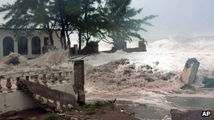 Waves, brought by Hurricane Sandy, crash on a house in the Caribbean Terrace neighbourhood in eastern Kingston, Jamaica