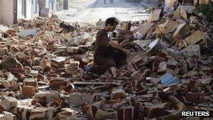 Man salvages bricks in Santiago after Hurricane Sandy hit - 27 October