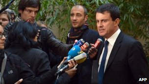 French Interior Minister, Manuel Valls (R) answers journalists' questions, on October 31, 2012 in Paris,