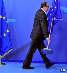 Man picking up EU flag