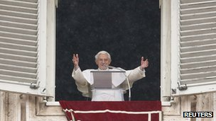 Pope Benedict XVI waves as he leads his Angelus prayer from the window of his private apartment in Saint Peter's Square at the Vatican.