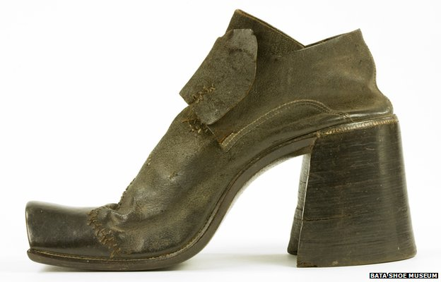 A man's high-heeled shoe