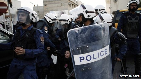 A Bahraini protestor is arrested by riot policemen during a demonstration 18 January 2013
