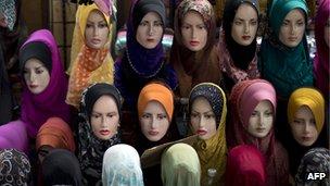 Hijabs displayed on mannequins