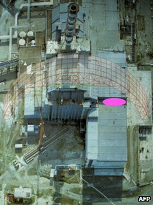 Aerial view of the Chernobyl nuclear plant with the collapsed roof section marked