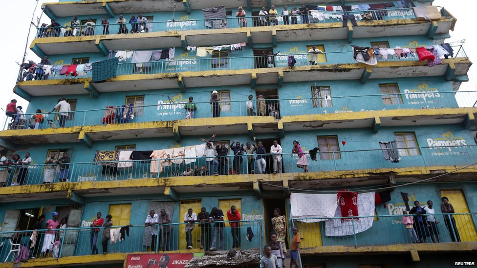 People look out from the balconies of a building in Mathare slum in the Kenyan capital Nairobi on 9 March 2013