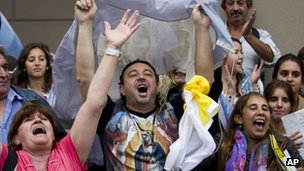 Argentine Catholics celebrate the election of their archbishop as pope in Buenos Aires on Wednesday