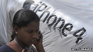 Indian woman in front of iPhone 4 logo in Hyderabad