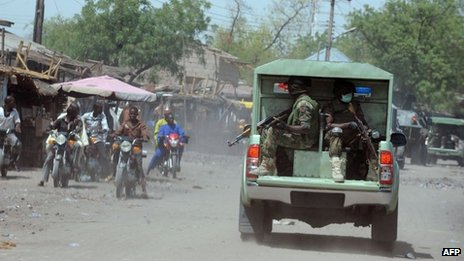 Troops patrol the streets of restive north-eastern Nigerian town of Maiduguri, Borno State, on 30 April 2013