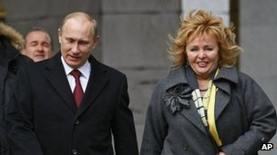 Russian Prime Minister and presidential candidate Vladimir Putin, left, and his wife Lyudmila arrive at a polling station in Moscow in March 2012