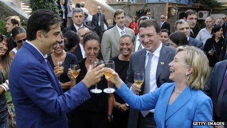 President Mikhail Saakashvili  toasting US Secretary of State Hilary Clinton