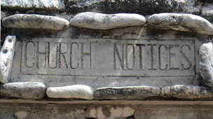 Stone sign: Church notices