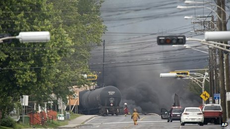 Smoke rises from railway cars carrying crude oil that derailed in Lac Megantic, Quebec, Canada, 6 July 2013