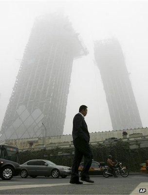 Man walking along a polluted street (Image: AP)