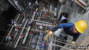 Worker climbs out of an underground construction site in Hefei, China