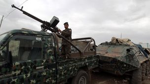 A Yemeni soldier mans a checkpoint on a street leading to the US embassy compound in Sanaa on August 4, 2013