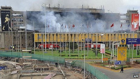 Smoke rises from Jomo Kenyatta International Airport. 7 Aug 2013