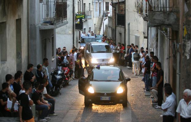 A funeral cortege passes through San Luca, Calabria