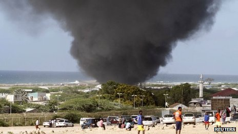 "Dark smoke rises above Abdule Airport in Somalia""s capital Mogadishu 9 August, 2013."