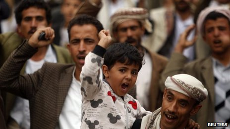 A boy shouts slogans during a demonstration against Israeli air strikes in Syria in Yemen