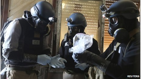 UN chemical weapons experts at one of the sites of an alleged chemical weapons attack in the Ain Tarma neighbourhood of Damascus, 29 August