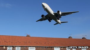 Jet plane over houses