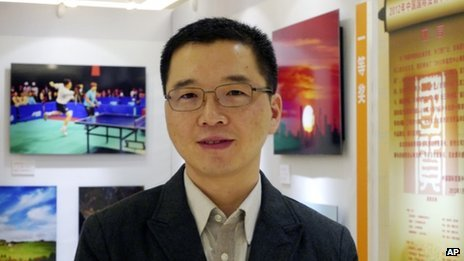 File photo: Yu Qiyi poses for a photo at an exhibition held at a hotel in Beijing, 2 September 2012
