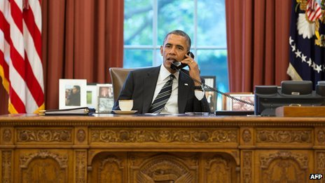 President Obama talks on the telephone to President Hassan Rouhani of Iran from the Oval Office (27 Sept 2013)