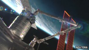 Cygnus cargo ship docking with International Space Station