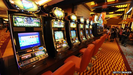 A row of gambling machines in Singapore's first casino that opened in 2010