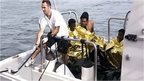 Surviving migrants aboard Italian coast guard vessel off Lampedusa, 3 Oct 13
