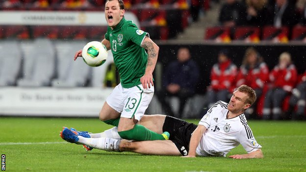 Anthony Stokes is tackled by Germany's Per Mertesacker