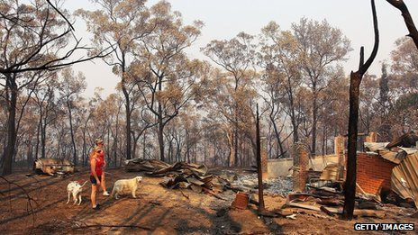 Melissa White assists her sister Christie Daschke at her home in Winmalee destroyed by bushfire on 21 October 2013