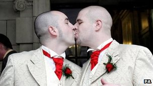 Two men kiss on the day of their civil partnership ceremony